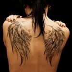 Тату крылья на спине у мужчин: 55 фото